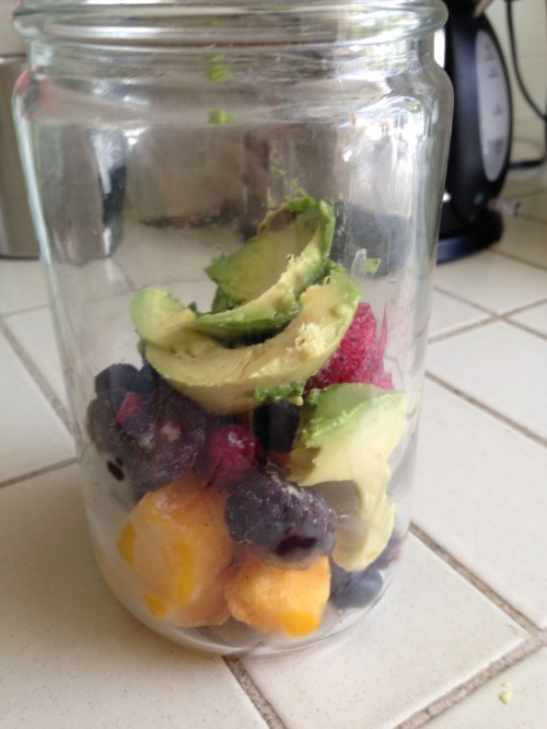 My big smoothie in the making: so far it's mango, berries, and avocado!