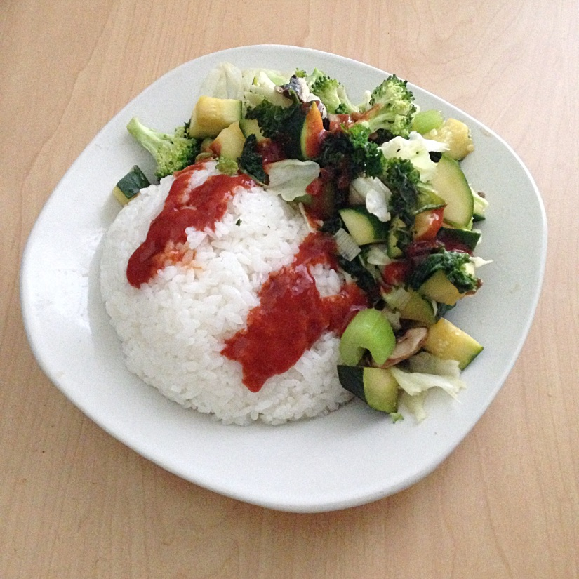 Tons of rice with veggies and sriracha. (I ate double the veggies but couldn't fit them on the plate for the photo!)